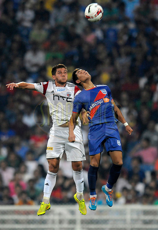 Guilherme Felipe de Castro of NorthEast United FC wins a header from Nadong Bhutia of Mumbai City FC during match 11 of the Hero Indian Super League between Mumbai City FC and North East United FC City held at the D.Y. Patil Stadium, Navi Mumbai, India on the 24th October 2014.<br /> <br /> Photo by:  Pal Pillai/ ISL/ SPORTZPICS
