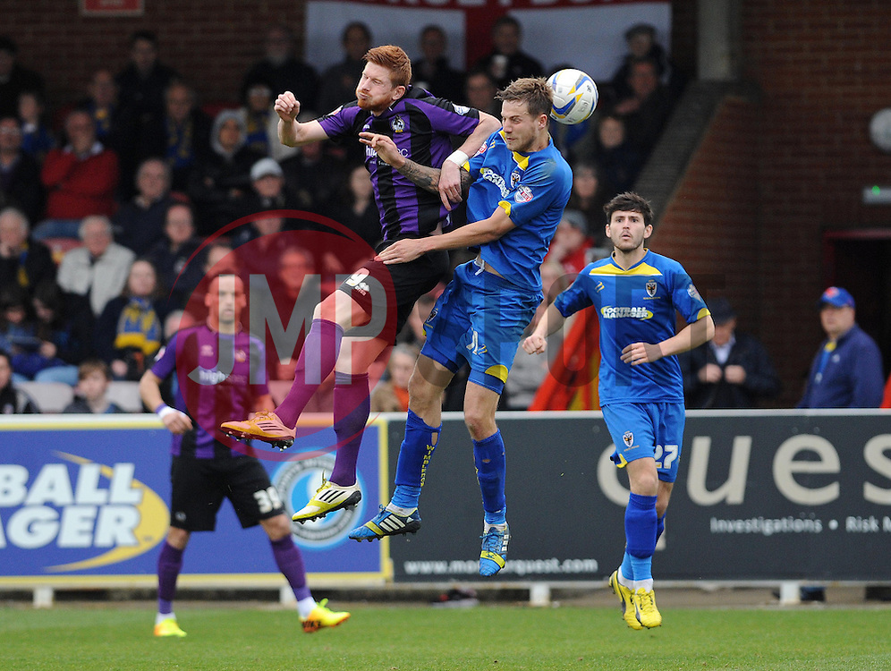 Bristol Rovers' Matt Harrold challenges AFC Wimbledon's Harry Pell to the header - Photo mandatory by-line: Dougie Allward/JMP - Mobile: 07966 386802 05/04/2014 - SPORT - FOOTBALL - Kingston upon Thames - Kingsmeadow - AFC Wimbledon v Bristol Rovers - Sky Bet League Two