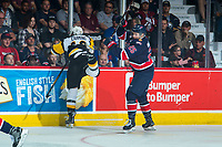 REGINA, SK - MAY 25: Scott Mahovlich #25 of Regina Pats checks Nicholas Caamano #10 of Hamilton Bulldogs during first period at the Brandt Centre on May 25, 2018 in Regina, Canada. (Photo by Marissa Baecker/CHL Images)