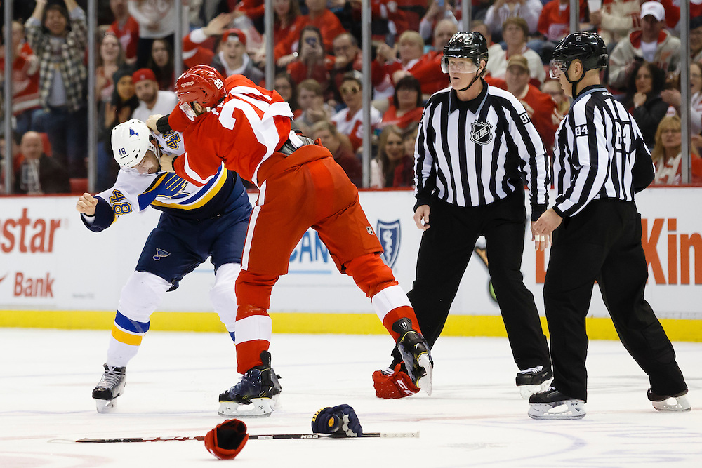 Mar 22, 2015; Detroit, MI, USA; St. Louis Blues defenseman Petteri Lindbohm (48) and Detroit Red Wings left wing Drew Miller (20) fight in the third period at Joe Louis Arena. Detroit won 2-1 in overtime. Mandatory Credit: Rick Osentoski-USA TODAY Sports