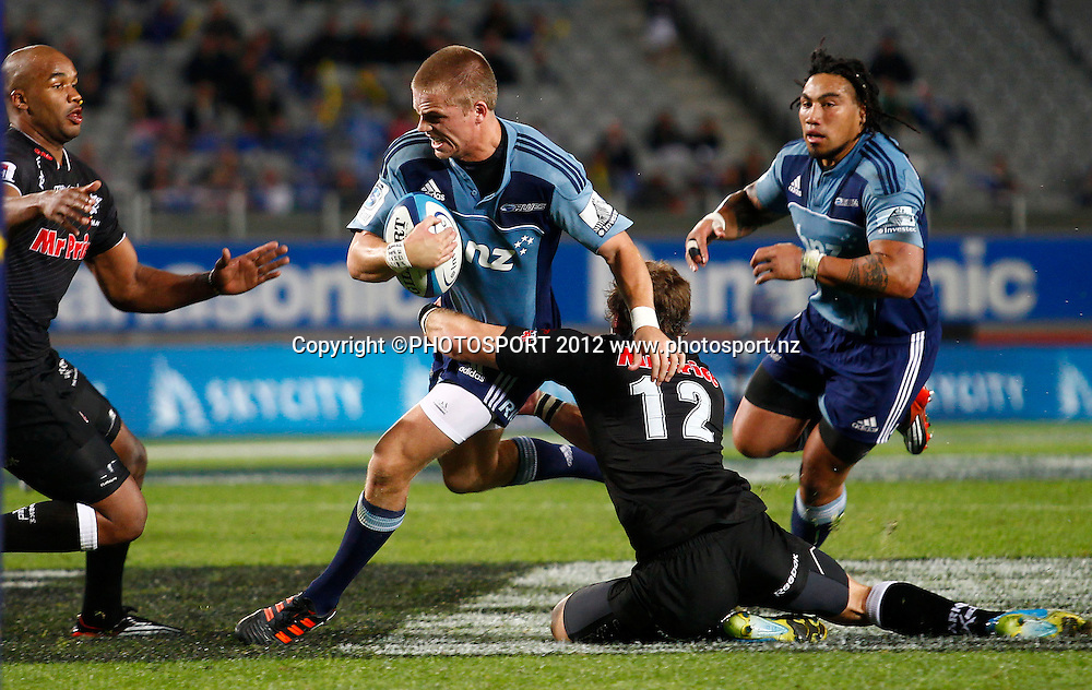 Gareth Anscombe of the Blues is tackled during the Super Rugby game between The Blues and The Sharks at Eden Park, Auckland New Zealand, Friday 13 April 2012. Photo: Simon Watts / photosport.co.nz