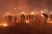 Mexicans try an avoid a barrage of sky rockets during the Alborada festival September 29, 2018 in San Miguel de Allende, Mexico. The unusual festival celebrates the cities patron saint with a two hour-long firework battle at 4am representing the struggle between Saint Michael and Lucifer.