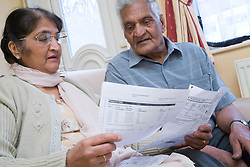 Older couple looking at household bills together,