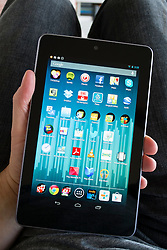 Man holding  Google Nexus tablet computer running android operating system