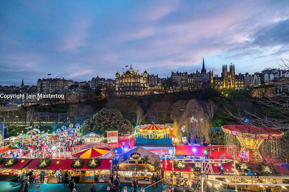 Evening view of funfair at annual Edinburgh Christmas Market in Scotland, United Kingdom