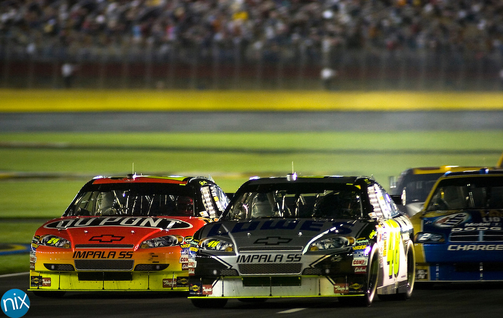Jimmie Johnson comes out of the pits, beating Jeff Gordon during the Sprint All Star Race Friday night at Lowe's Motor Speedway. Photo by James Nix