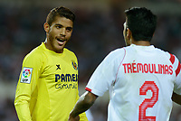 Villarreal J. Dos Santos (L) it confronts the Sevilla's player Tremoulinas during the match between Sevilla FC and Villarreal day 9 spanish  BBVA League 2014-2015 day 5, played at Sanchez Pizjuan stadium in Seville, Spain. (PHOTO: CARLOS BOUZA / BOUZA PRESS / ALTER PHOTOS)
