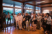 People listen the speech of the French ambassador Thierry Dana at French Embassy on July 15, 2016 in Tokyo, Japan. At least 84 people were killed when a truck ploughs into crowd celebrating in Bastille Day in the city of Nice. 15/07/2016-Tokyo, JAPAN