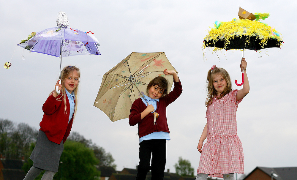 Stand alone.Children at Glade Hill Primary School, in Bestwood had a parade around their school with customized and Easter themed umbrellas to mark the start of spring...From left: Sharnay Whitaker, Shauna Hunt, Millie Huthwaite with their Easter umbrellas..Picture by: Shawn Ryan... .