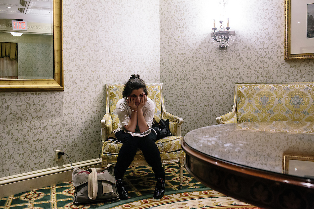 "Daniela Shia-Sevilla, 15, writes poetry in an empty corner of the Willard Hotel near the spa where her mom works. She said she draws inspiration from the world around her and by remembering experiences throughout her day. ""I'm writing in my head every second,"" Shia- Sevilla said."