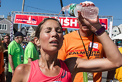 Sara Hall, runner up, pours water over her head on a hot and humid day for racing with temps near 80