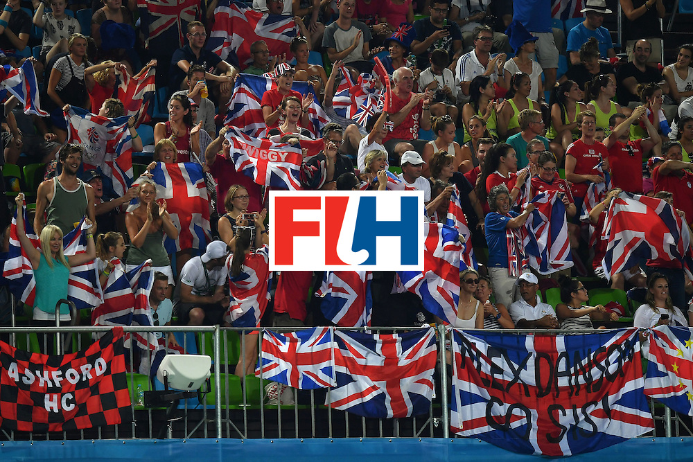 Britain fans cheer their team during the women's semifinal field hockey New Zealand vs Britain match of the Rio 2016 Olympics Games at the Olympic Hockey Centre in Rio de Janeiro on August 17, 2016. / AFP / MANAN VATSYAYANA        (Photo credit should read MANAN VATSYAYANA/AFP/Getty Images)