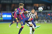 Barcelona Gerard Piqué and Carlos Tévez of Juventus during the Champions League Final between Juventus FC and FC Barcelona at the Olympiastadion, Berlin, Germany on 6 June 2015. Photo by Phil Duncan.
