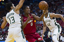 January 14, 2018 - Miami, FL, USA - Miami Heat guard Josh Richardson (0) fights for possession against Milwaukee Buck's guard Malcolm Brogdon (13) in the first quarter on Sunday, Jan. 14, 2018 at the AmericanAirlines Arena in Miami, Fla. (Credit Image: © Matias J. Ocner/TNS via ZUMA Wire)