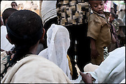 "Jerusalem at her wedding. She is a really young bride of 8 years old, and she is being married with a guy 10 years older. Moments of the Orthodox function celbrating in a small village. In Ethiopia 60 percent of girls younger than 18 are married. In the Amhara region, half of girls younger than 15 are married. In forced marriage, the parents choose their son's or daughter's future spouse with no input from the son or daughter. North West of Ethiopia, on saturday, Febrary 14 2009.....In a tangled mingling of tradition and culture, in the normal place of living, in a laid-back attitude. The background of Ethiopia's ""child brides"", a country which has the distinction of having highest percentage in the practice of early marriages despite having a law that establishes 18 years as minimum age to get married. Celebrations that last days, their minds clouded by girls cups of tella and the unknown for the future. White bridal veil frame their faces expressive of small defenseless creatures, who at the age ranging from three to twelve years shall be given to young brides men adults already...To protect the identities of the recorded subjects names and specific places are fictional."