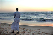 Mauritania October 27, 2006 - Man taking a walk along a beach in Nouakchott. ©Jean-Michel Clajot