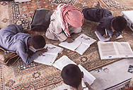 Children of the Al Amrah clan studying in their desert school, Saudi Arabia