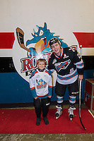 KELOWNA, CANADA - DECEMBER 4: Tyson Baillie #24 of Kelowna Rockets stand with a young fan on December 4, 2015 at Prospera Place in Kelowna, British Columbia, Canada.  (Photo by Marissa Baecker/Shoot the Breeze)  *** Local Caption *** Tyson Baillie;