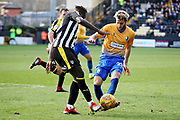 Mansfield Town midfielder Jorge Grant just beats Notts County forward Lewis Alessandra Virgil Gomis (10) to the ball during the EFL Sky Bet League 2 match between Notts County and Mansfield Town at Meadow Lane, Nottingham, England on 16 February 2019.