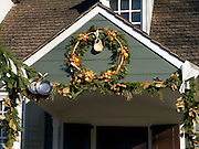 Christmas decorations on house; wreath; garland with pans; Colonial Williamsburg; Williamsburg; VA; winte