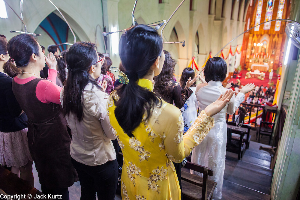 08 APRIL 2012 - HANOI, VIETNAM:    Women pray during Easter Sunday mass in St. Joseph Cathedral in Hanoi, Vietnam. St. Joseph Cathedral in Hanoi is the seat of the Roman Catholic Archdiocese of Hanoi and is one of the most important Catholic churches in Vietnam. It was built in 1886 and is especially crowded on religious holidays, like Easter. The church holds three Easter masses on Easter Sunday morning. There are more than 5.6 million Roman Catholics in Vietnam, nearly 7% of the population. Catholicism came to what is now Vietnam with Portuguese missionaries in the 16th Century, but it wasn't until the arrival of French missionaries and later colonial authorities that Catholicism became a part of Vietnamese religious life.     PHOTO BY JACK KURTZ