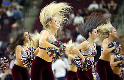 Members of the Texas A&M dance team performs during a time out of a NCAA college basketball game between Texas A&M and Florida Gulf Coast University in College Station, Texas, Wednesday, Dec. 2, 2015. Texas A&M's Anthony Collins (11) fouls  (AP Photo/Sam Craft)