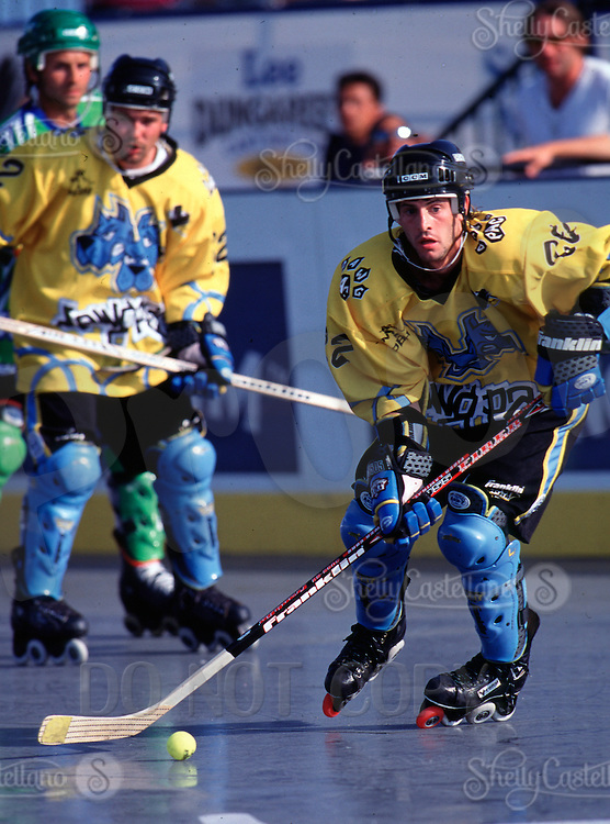 2000: Pro Beach Hockey PBH outdoor roller hockey game.  Garvey action shot with stick, skates and ball in action. Dawgpack.