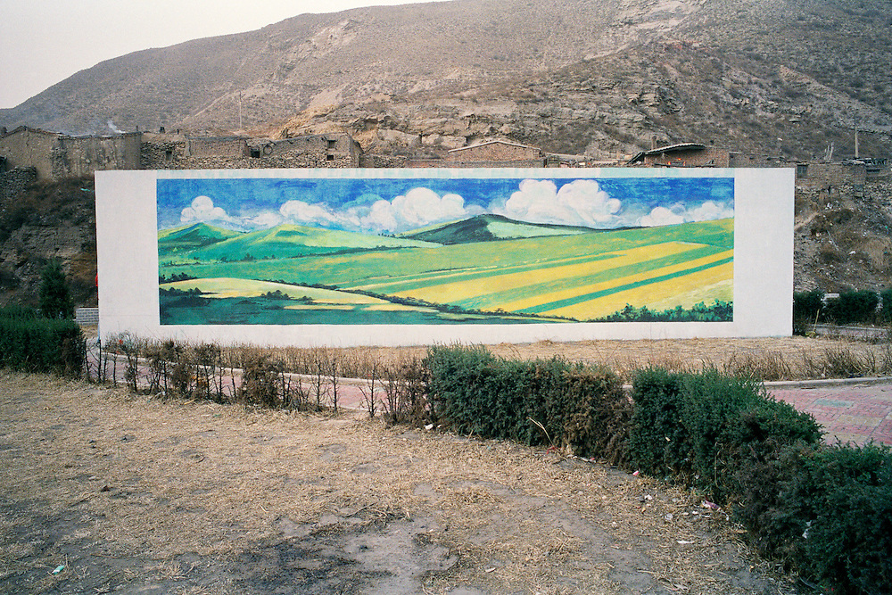 A mural decorates a wall and is in direct contrast to the ravaged landscape in this mining area in Shanxi province. From mine to sky, from extraction to combustion -- coal pollutes every step of the way. From acid drainage from coal mines, polluting rivers and streams, to the release of mercury and other toxins when it is burned, as well as climate-destroying gases and fine particulates that wreak havoc on human health, coal is unquestionably, a dirty business. China. 2006