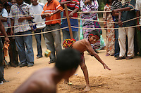 Wayuu Indian boys compete in a competition where they try to hit each other by throwing chunks of cactus, the event is part of the annual Wayuu Cultural Festival in Uribia, Colombia June 9, 2007. (Photo/Scott Dalton)