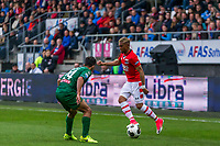 ALKMAAR - 01-04-2017, AZ - FC Groningen, AFAS Stadion, FC Groningen speler Tom Hiariej, AZ speler Dabney dos Santos Souza