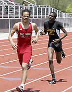 Trotwood (left) and Meadowdale (right) compete in the combined Boys and Girls 3200 Meter Run during the Buff Taylor Memorial Track & Field Invitational at the Good Samaritan Sports Plex at Trotwood Madison High School, Saturday, May 10, 2008.