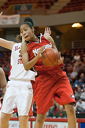 26 November 2005: Nikita Odom brings in a rebound in front of Nicolle Lewis. The Illinois State Redbirds were triumphant over the Northern Illinois Huskies 60 - 50 at the final buzzer.  The game was played at Redbird Arena on the campus of Illinois State University in Normal IL