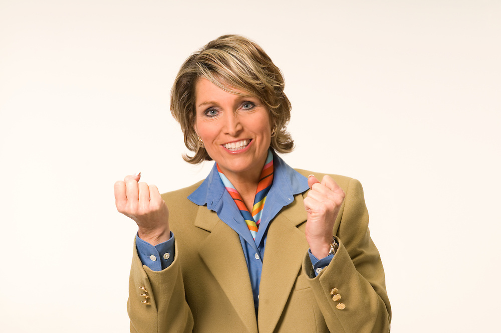 Middle-aged businesswoman studio shot against a white background.