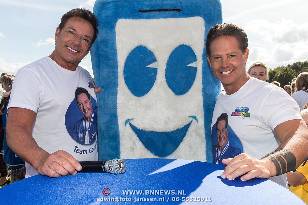 NLD/Amsterdam/20180925 - BN'ers over stormbaan voor metabole ziekte, Danny de Munck met Gerard Joling