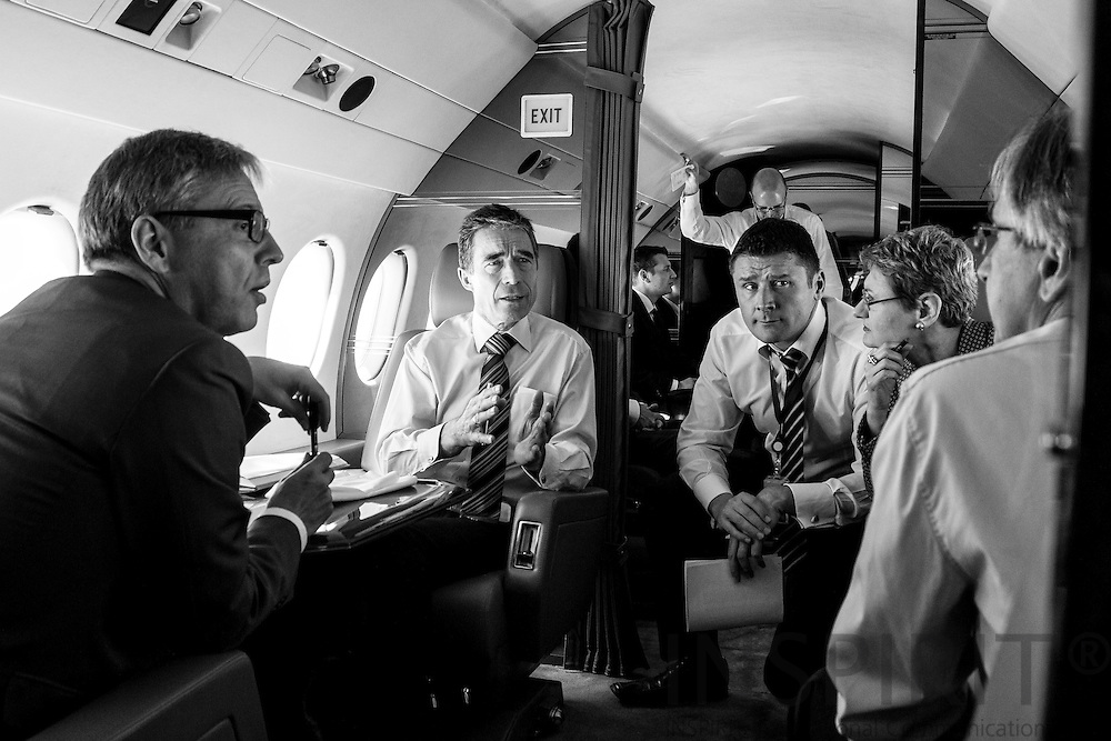 As part of his preparation for the NATO Summit in Chicago in May was the NATO Secretary General Anders Fogh Rasmussen busy traveling to different Member States for meetings with Heads of States and ministers. No time was wasted as here in the plane planning and discussing with his close advisers. From left his Director, Ambassador  Jesper Vahr, Personal Adviser Jonas Torp, Spokesperson Oana Lungescu and Assistant Secretary General Dirk Brengelmann.
