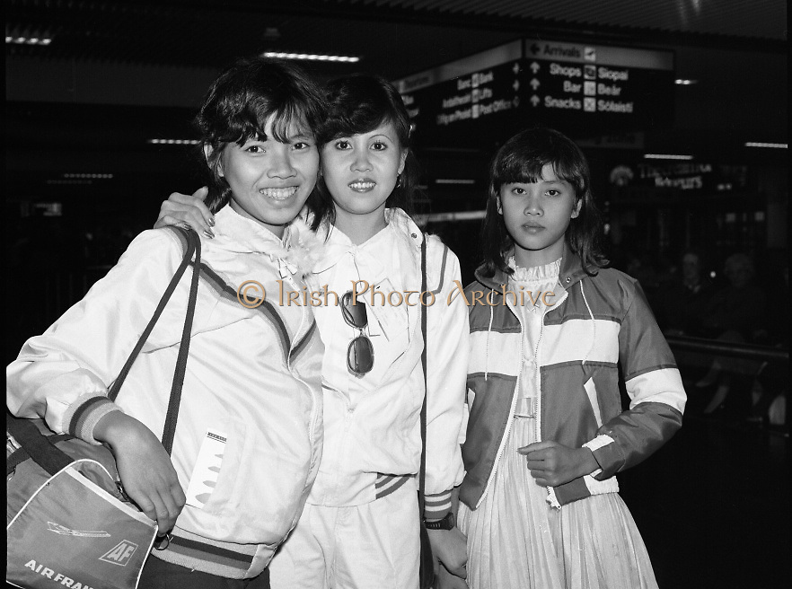 Vietnamese Refugees at Dublin Airport..1985..20.03.1985..03.20.1985..20th March 1985..After the Vietnam war,many European countries opened their doors to the dispossessed. The United Nations and several charities were to the forefront of the campaign to resettle some of the population away from the horrors of a war which had devastated large areas of Vietnam...Image shows the arrival to Dublin of, Pham Thi Thiy, Nguyen thi Dung and Pham Thi Thao. They arrived in Dublin after flying in through Amsterdam. The children were lucky as they had previously settled family, at the airport, to meet them.
