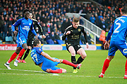 Peterborough United defender Steven Taylor (27) tackles Leicester City midfielder Demarai Gray (7) on the edge of the box during the The 4th round FA Cup match between Peterborough United and Leicester City at London Road, Peterborough, England on 27 January 2018. Photo by Nigel Cole.