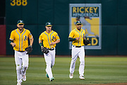 The Oakland Athletics run in from the outfield during a MLB game against the Los Angeles Angels at Oakland Coliseum in Oakland, California, on September 5, 2017. (Stan Olszewski/Special to S.F. Examiner)