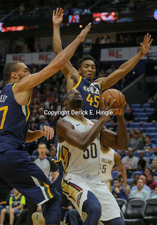 Mar 11, 2018; New Orleans, LA, USA; New Orleans Pelicans center Emeka Okafor (50) is defended by Utah Jazz center Rudy Gobert (27) and guard Donovan Mitchell (45) during the first half at the Smoothie King Center. Mandatory Credit: Derick E. Hingle-USA TODAY Sports