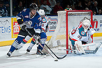 KELOWNA, CANADA -FEBRUARY 8: Mitchell Wheaton #6 of the Kelowna Rockets stick checks Steven Hodges #11 of the Victoria Royals as he tries to score a wrap around goal on Jordon Cooke #30 of the Kelowna Rockets during the second period on February 8, 2014 at Prospera Place in Kelowna, British Columbia, Canada.   (Photo by Marissa Baecker/Getty Images)  *** Local Caption *** Mitchell Wheaton; Jordon Cooke; Mitch Wheaton; Steven Hodges;