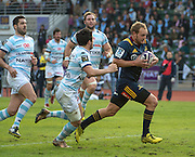 Highlanders player MATT FADDES (c) clears Racing 92 player, BRICE DULIN to score a try (L) the Natixis Cup rugby match between French team Racing 92 and New Zealand team Otago Highlanders at Sui San Wan Stadium in Hong Kong