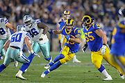 Jan 12, 2019; Los Angeles, CA, USA;  Los Angeles Rams tight end Tyler Higbee (89) carries the ball against the Dallas Cowboys during an NFL divisional playoff game at the Los Angeles Coliseum. The Rams beat the Cowboys 30-22. (Kim Hukari/Image of Sport)