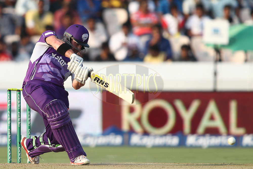 Travis Birt of the Hobart Hurricanes drives a delivery during the first semi final match of the Oppo Champions League Twenty20 between the Kolkata Knight Riders and the Hobart Hurricanes held at the Rajiv Gandhi Cricket Stadium, Hyderabad, India on the 2nd October 2014<br /> <br /> Photo by:  Shaun Roy / Sportzpics/ CLT20<br /> <br /> <br /> Image use is subject to the terms and conditions as laid out by the BCCI/ CLT20.  The terms and conditions can be downloaded here:<br /> <br /> http://sportzpics.photoshelter.com/gallery/CLT20-Image-Terms-and-Conditions-2014/G0000IfNJn535VPU/C0000QhhKadWcjYs