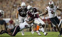 Texas A&M running back Keith Ford (7) is tackled by South Carolina linebacker Sherrod Greene (44) after picking up yards during the fourth quarter of an NCAA college football game Saturday, Sept. 30, 2017, in College Station, Texas. (AP Photo/Sam Craft)