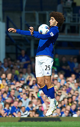 LIVERPOOL, ENGLAND - Saturday, October 1, 2011: Liverpool's Marouane Fellaini in action against Everton during the Premiership match at Goodison Park. (Pic by David Rawcliffe/Propaganda)