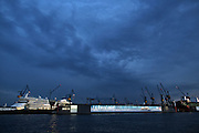 Hamburg | 30 Apr 2015<br /> <br /> The criuse ship AIDA (l) is on repair at Blohm &amp; Voss shipyard at the river Elbe.<br /> <br /> &copy;peter-juelich.com<br /> <br /> [No Model Release | No Property Release]