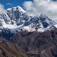 "Cholatse (6440m) and Tobuche (6500m) behind Phortse village. Seen from ""Everest View Hotel""."