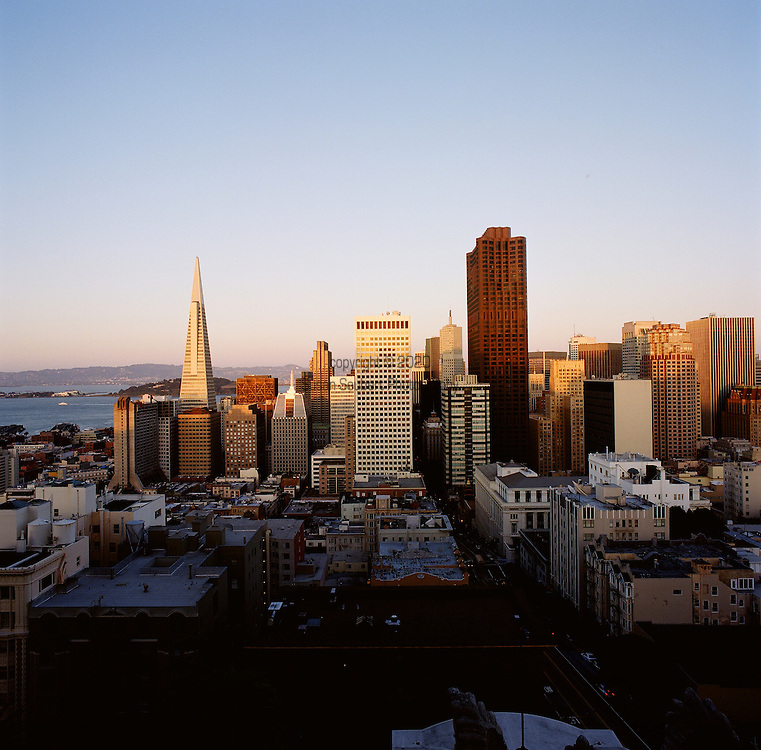 The Transamerica Building dominates the dusk skyline view from the penthouse at the Fairmont San Francisco, California