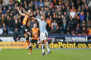 Hull City midfielder Robert Snodgrass (10)  climbs with Huddersfield Town defender Tommy Smith (2)  during the Sky Bet Championship match between Huddersfield Town and Hull City at the John Smiths Stadium, Huddersfield, England on 9 April 2016. Photo by Simon Davies.