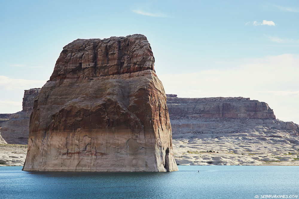 Stand up paddle (SUP) boarding near Lone Rock, Lake Powell, Utah.